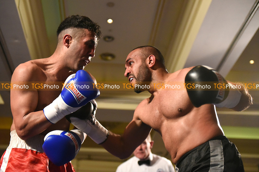 Ibrar Riyaz (black shorts) defeats Yadollah Ghasemi during a Boxing Show at the Millenium Hotel on 11th May 2017