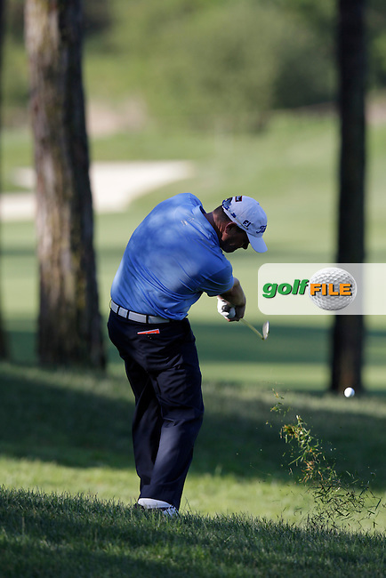 David Drysdale (SCO) plays his 2nd shot from the rough on the 3rd hole during Friday's Round 2 of the 2014 Open de Espana held at the PGA Catalunya Resort, Girona, Spain. Wednesday 16th May 2014.<br /> Picture: Eoin Clarke www.golffile.ie