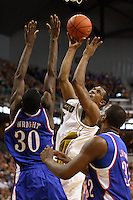 Tigers forward Marshall Brown goes to the basket over Kansas forward Julian Wright during the first half at Mizzou Arena in Columbia, Missouri on February 10, 2007. The Jayhawks won 92-74.