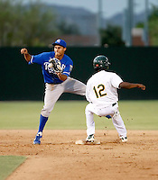 Mike Antonio - AZL Royals - 2010 Arizona League. Antonio takes a throw from the catcher on an attempted steal by Jemile Weeks of the Athletics in an Arizona League game at Papago Park, Phoenix, AZ 0 97/11/2010..Photo by:  Bill Mitchell/Four Seam Images..
