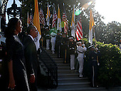 U.S. President Barack Obama and first Lady Michelle Obama walk out to welcome Pope Francis prior to his arrival ceremony at the White House on September 23, 2015 in Washington, DC. The Pope begins his first trip to the United States at the White House followed by a visit to St. Matthew's Cathedral, and will then hold a Mass on the grounds of the Basilica of the National Shrine of the Immaculate Conception.<br /> Credit: Alex Wong / Pool via CNP