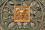 The gold face and detail of the gate to the Royal Palace in Turin, Italy