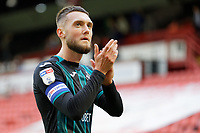 Matt Grimes of Swansea City thanks away supporters during the Sky Bet Championship match between Barnsley and Swansea City at Oakwell Stadium, Barnsley, England, UK. Saturday 19 October 2019