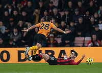 Wolverhampton Wanderers' Joao Moutinho (left) is tackled by Bournemouth's Lewis Cook (right) <br /> <br /> Photographer David Horton/CameraSport<br /> <br /> The Premier League - Bournemouth v Wolverhampton Wanderers - Saturday 23rd November 2019 - Vitality Stadium - Bournemouth<br /> <br /> World Copyright © 2019 CameraSport. All rights reserved. 43 Linden Ave. Countesthorpe. Leicester. England. LE8 5PG - Tel: +44 (0) 116 277 4147 - admin@camerasport.com - www.camerasport.com