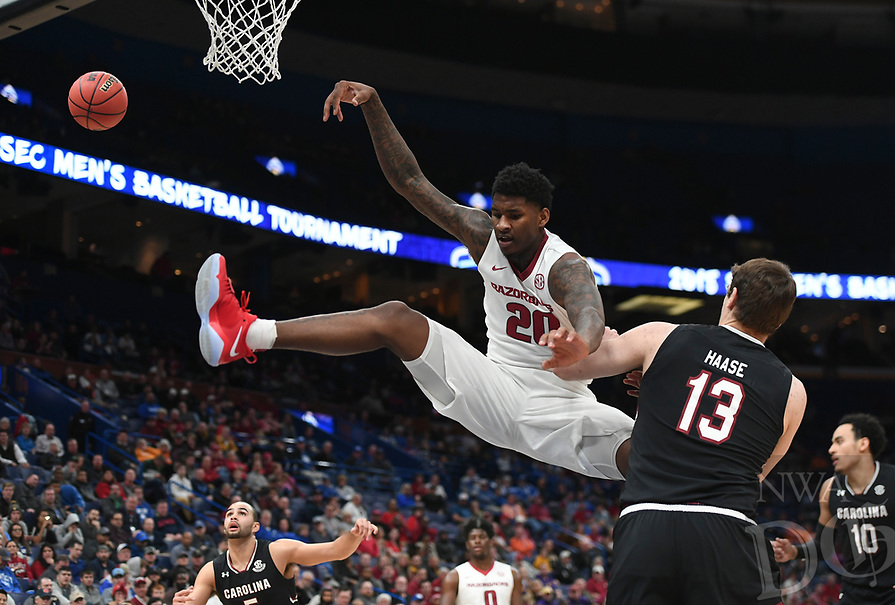 NWA Democrat-Gazette/CHARLIE KAIJO Arkansas Razorbacks forward Darious Hall (20) attempts a dunk during the Southeastern Conference Men's Basketball Tournament, Thursday, March 8, 2018 at Scottrade Center in St. Louis, Mo.