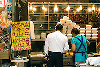 A roadside food stall near the street markets in the gritty Canal Road area of Hong Kong..