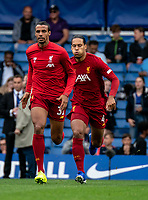 Joel Matip of Liverpool and Virgil van Dijk of Liverpool during the Premier League match between Chelsea and Liverpool at Stamford Bridge, London, England on 22 September 2019. Photo by Liam McAvoy / PRiME Media Images.