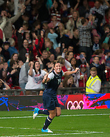 Manchester, England - Monday, August 6, 2012: The USA defeated Canada 4-3 in overtime in the semi-final round of the 2012 London Olympics at Old Trafford. Abby Wambach celebrates Alex Morgan's game winning goal.