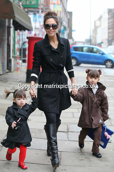 NON EXCLUSIVE PICTURE: MATRIXPICTURES.CO.UK.PLEASE CREDIT ALL USES..WORLD RIGHTS..British media personality Myleene Klass is pictured walking in North London with her daughters Ava and Hero...MARCH 19th 2013..REF: WTX 131816