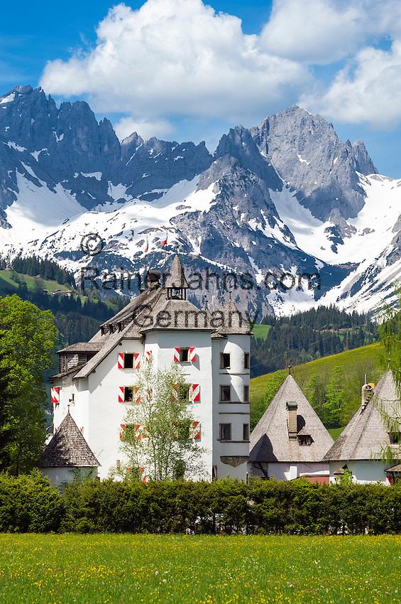 Austria, Tyrol, Reith near Kitzbuehel: Castle Muenichau, Hotel and restaurant with Wilder Kaiser mountains | Oesterreich, Tirol, Reith bei Kitzbuehel: Schloss Muenichau, Hotel und Restaurant vorm Wilder Kaiser Gebirge