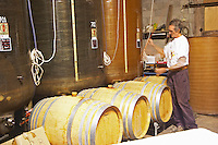 Michel Moreau Domaine de Terre Megere, Cournonsec, Montpellier. Gres de Montpellier. Languedoc. Barrel cellar. Batonnage, stirring of the lees with a stave. France. Europe.
