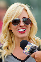 Courtney Force (13) of Team NHRA is interviewed prior to the NASCAR vs NHRA Charity Softball Challenge at CMC-Northeast Stadium on April 17, 2013 in Kannapolis, North Carolina.  Team NHRA defeated Team NASCAR 19-5.  (Brian Westerholt/Four Seam Images)