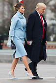 United States President Donald Trump and First Lady Melania Trump walk back to the Capitol Building after former President Barack Obama departed the inauguration, on Capitol Hill in Washington, D.C. on January 20, 2017. President-Elect Donald Trump was sworn-in as the 45th President.    <br /> Credit: Kevin Dietsch / Pool via CNP