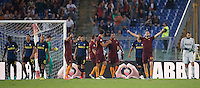 Calcio, Serie A: Roma vs Inter. Roma, stadio Olimpico, 2 ottobre 2016.<br /> Roma&rsquo;s players celebrate as Inter's players leave the pitch at the end of the Italian Serie A football match between Roma and FC Inter at Rome's Olympic stadium, 2 October 2016. Roma won 2-1.<br /> UPDATE IMAGES PRESS/Riccardo De Luca
