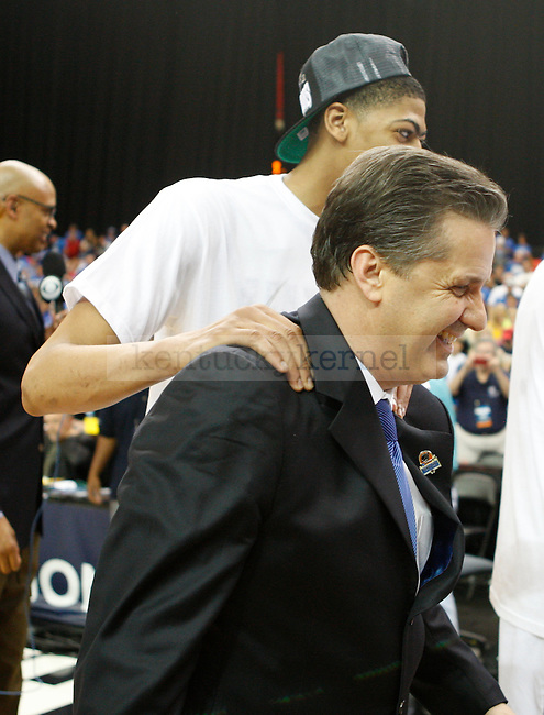 Anthony Davis pats head coach of Kentucky, John Calipari, on the back after defeating Baylor University 82-70 in the south region final of the NCAA Tournament, in the Georgia Dome, on Sunday, March 25, 2012 in Atlanta, Ga.  Photo by Latara Appleby | Staff. ..