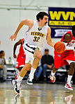 12 December 2010: University of Vermont Catamount forward Evan Fjeld, a Senior from Durham, NC, in action against the Marist College Red Foxes at Patrick Gymnasium in Burlington, Vermont. The Catamounts (7-2) defeated the Red Foxes  75-67 notching their 7th win of the season, and their best start since the '63-'64 season. Mandatory Credit: Ed Wolfstein Photo