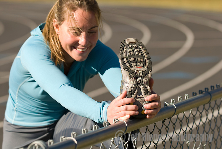 A young woman stretches before a run in Jackson, Wyoming.