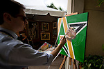 HALLANDALE BEACH, FL - JANUARY 27: An artist paints a portrait of a jockey on Pegasus World Cup Invitational Day at Gulfstream Park Race Track on January 27, 2018 in Hallandale Beach, Florida. (Photo by Scott Serio/Eclipse Sportswire/Getty Images)