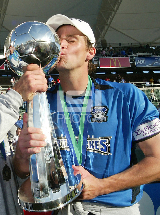 Ronnie Ekelund kisses the MLS Cup after the Earthquakes defeated Chicago Fire 4-2 in the MLS Championship, in Carson, Calif.