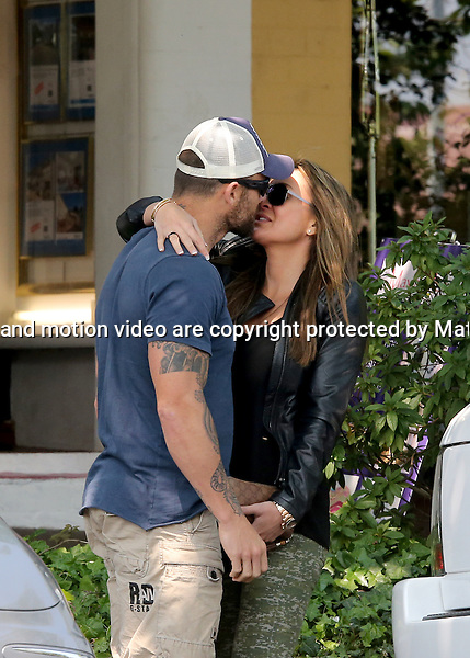 18 OCTOBER  2013 SYDNEY AUSTRALIA<br /> <br /> EXCLUSIVE PICTURES<br /> <br /> Michelle Bridges pictured with Commando Steve Willis leaving a Leura restaurant after a romantic lunch together and walking back to their car where they stopped for a little smooch.<br /> <br /> *No internet without clearance*.<br /> MUST CALL PRIOR TO USE <br /> +61 2 9211-1088. <br /> <br /> Matrix Media Group.Note: All editorial images subject to the following: For editorial use only. Additional clearance required for commercial, wireless, internet or promotional use.Images may not be altered or modified. Matrix Media Group makes no representations or warranties regarding names, trademarks or logos appearing in the images.