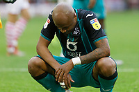 Andre Ayew of Swansea City sits dijected after the final whistle during the Sky Bet Championship match between Barnsley and Swansea City at Oakwell Stadium, Barnsley, England, UK. Saturday 19 October 2019