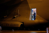 A member of an honor guard watches over the flag-draped coffin of TSGT Joseph Lemm inside of a C-17 transport plane at Stewart Air National Guard Base before the dignified transfer ceremony.  Lemm, also a New York City Police Detective, was killed in December 2015 along with five fellow soldiers by a suicide bomber in Afghanistan.