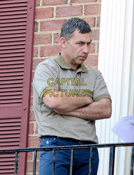 Ruslan Tsarni, Uncle of Boston Marathon bombing suspect Dzhokhar Tsarnaev, gives an interview outside his home in Montgomery Village, Maryland on Saturday, April 20, 2013.  .half length grey gray top blue jeans denim arms crossed .CAP/ADM/CP/RS.©Ron Sachs/CNP/AdMedia/Capital Pictures.