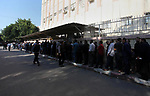 Palestinian employees of Gaza strip wait to receive their salaries at a Post Office, in Gaza city, on November 9, 2018. Officials in Gaza said that NIS 90 million in funds from Qatar were transferred to the territory. Government employees receive their salaries for the month of August on Friday. Their salaries for September and October are to be paid soon as well. The Qatari funds are for civilian employees only and not security services. Photo by Mahmoud Ajour