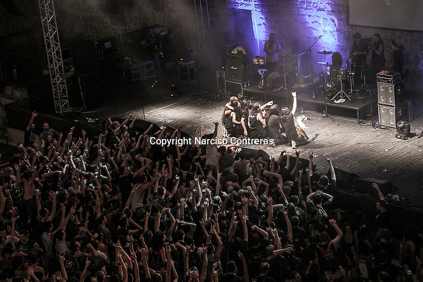 August 27, 2014 - Binyamina, Haifa District, Israel: The musicians at Orphaned Land heavy metal band pose for picture with their fans as they perform a concert in Binyamina Amphitheatre at north of Israel. Orphaned Land is a music band founded by Jewish and Arabian musicians who combine ethnic music with rock metal as they recite verses in Hebrew and Arabic from the sacred Quram and Tora Scriptures. (Narciso Contreras/Polaris)