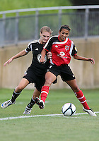 BOYDS, MARYLAND - July 21, 2012:  Ashley Herndon (15) of DC United Women pushes into the back of Taylor Mertz (5) of the Virginia Beach Piranhas during a W League Eastern Conference Championship semi final match at Maryland Soccerplex, in Boyds, Maryland on July 21. DC United Women won 3-0.