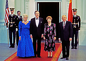 United States President George H.W. Bush, left center, and President Mikhail Gorbachev of the Union of Soviet Socialist Republics, right, pose for a group photo with their wives in front of the North Portico of the White House in Washington, DC prior to a state dinner  on Thursday, May 31, 1990.  From left to right: First lady Barbara Bush, President Bush, Raisa Gorbachev, and President Gorbachev.<br /> Credit: Dennis Brack / Pool via CNP