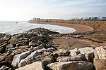 Rock armour boulders used as coastal defence against rapid erosion at East Lane, Bawdsey, Suffolk, England, UK
