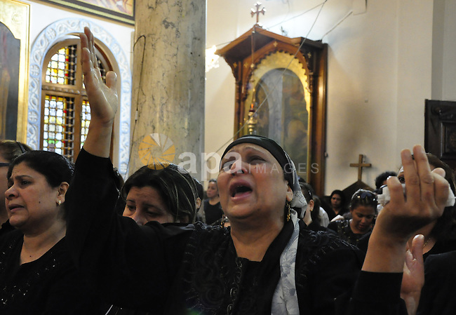 "Christian woman mourns during the funeral of a victim of sectarian clashes in Cairo on May 8, 2011 as Egypt's military rulers warned they will use an ""iron hand"" to protect national security after clashes between Muslims and Christians in the Egyptian capital killed 12 people and injured scores. Photo by Ahmed Asad"