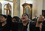 """Christian woman mourns during the funeral of a victim of sectarian clashes in Cairo on May 8, 2011 as Egypt's military rulers warned they will use an """"iron hand"""" to protect national security after clashes between Muslims and Christians in the Egyptian capital killed 12 people and injured scores. Photo by Ahmed Asad"""