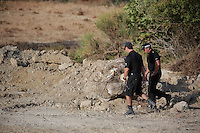 Pictured: Two forensics officers walk through the new site in Kos, Greece. Saturday 08 October 2016<br />