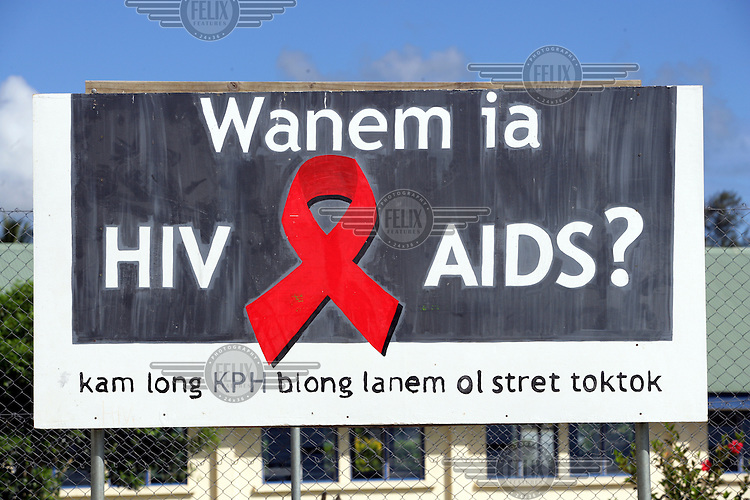 A billboard warning against HIV/AIDS in the playground of the Wan Small Bag Theatre, a centre for young people run by a local NGO and financially supported by UNICEF. The centre is a meeting point for children and youth and offers vocational training, art workshops and more. It is situated in the Tagabe suburb of Port Vila.