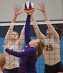 Collinsville'sr Kayla Hancher (center) tries to tip the ball over as O'Fallon players Katherine Toftemark (left) and Kenzie Simmers leap to block. O'Fallon defeated Collinsville to win the Class 4A Regional volleyball title at Belleville East High School on Thursday October 25, 2018. <br /> Tim Vizer/Special to STLhighschoolsports.com