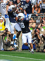 06 September 2014:  Penn State TE Jesse James (18) celebrates with Eugene Geno Lewis (7) after his second touchdown of the game. The Penn State Nittany Lions defeated the Akron Zips 21-3 at Beaver Stadium in State College, PA.