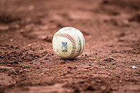 A baseball sits in the dirt between innings as the Salt Lake Bees played the Sacramento River Cats at Smith's Ballpark on April 17, 2015 in Ogden, Utah.  (Stephen Smith/Four Seam Images)