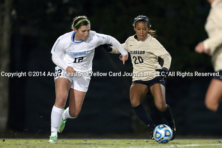 21 November 2014: Colorado's Brie Hooks (20) and North Carolina's Jessie Scarpa (12). The University of North Carolina Tar Heels hosted the University of Colorado Buffaloes at Fetzer Field in Chapel Hill, NC in a 2014 NCAA Division I Women's Soccer Tournament Second Round match. UNC won the game 1-0 in overtime.