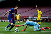 1st October 2017, Camp Nou, Barcelona, Spain; La Liga football, Barcelona versus Las Palmas; Leo Messi of FC Barcelona dribbles the goalkeeper and scores the 2-0, as the game is played behind closed doors due to the riots in Barcelona during the Catlaonio referendum