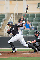 Micker Aldofo (27) of the Kannapolis Intimidators follows through on his swing against the Augusta GreenJackets at Kannapolis Intimidators Stadium on May 3, 2017 in Kannapolis, North Carolina.  The Intimidators defeated the GreenJackets 7-4.  (Brian Westerholt/Four Seam Images)