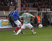 Ryan Sinnamon crosses past Calum Waters in the Celtic v Rangers City of Glasgow Cup Final match played at Firhill Stadium, Glasgow on 29.4.13,  organised by the Glasgow Football Association and sponsored by City Refrigeration Holdings Ltd.