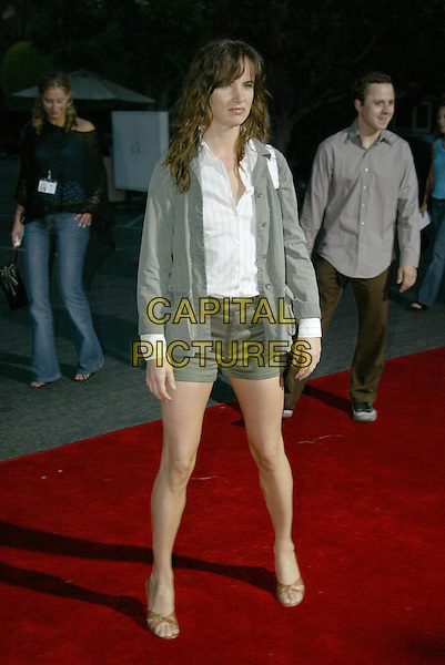 JULIETTE LEWIS.At 'Without A Paddle' World Premiere held at Paramount Pictures. Hollywood, CA, USA.August16, 2004.full length, looking sad, striped shirt, green shorts, jacket, coat.www.capitalpictures.com.sales@capitalpictures.com.© 2004 by Charles Harris.