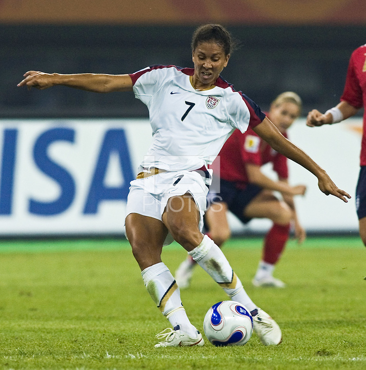 USA midfielder (7) Shannon Boxx shoots for her goal. The United States (USA) defeated England (ENG) 3-0 during a quarter-final match of the FIFA Women's World Cup China 2007 at Tianjin Olympics Center Stadium in Tianjin, China, on September 22, 2007.