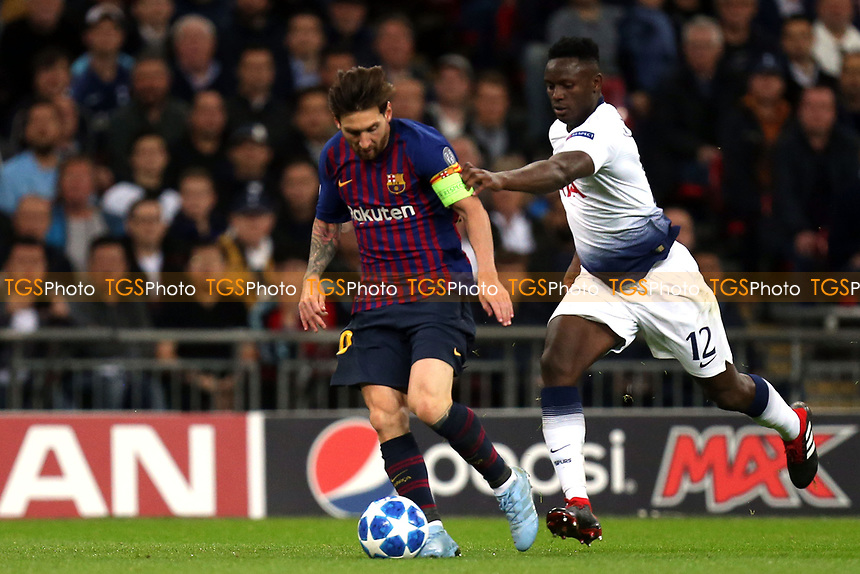 Lionel Messi of FC Barcelona and Victor Wanyama of Tottenham Hotspur during Tottenham Hotspur vs FC Barcelona, UEFA Champions League Football at Wembley Stadium on 3rd October 2018