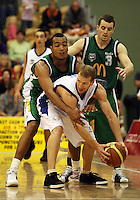 Manawatu's Marcel Jones fouls Hayden Allen during the NBL Round 5 match between the Manawatu Jets  and Auckland Stars at Arena Manawatu, Palmerston North, New Zealand on Friday 10 April 2009. Photo: Dave Lintott / lintottphoto.co.nz