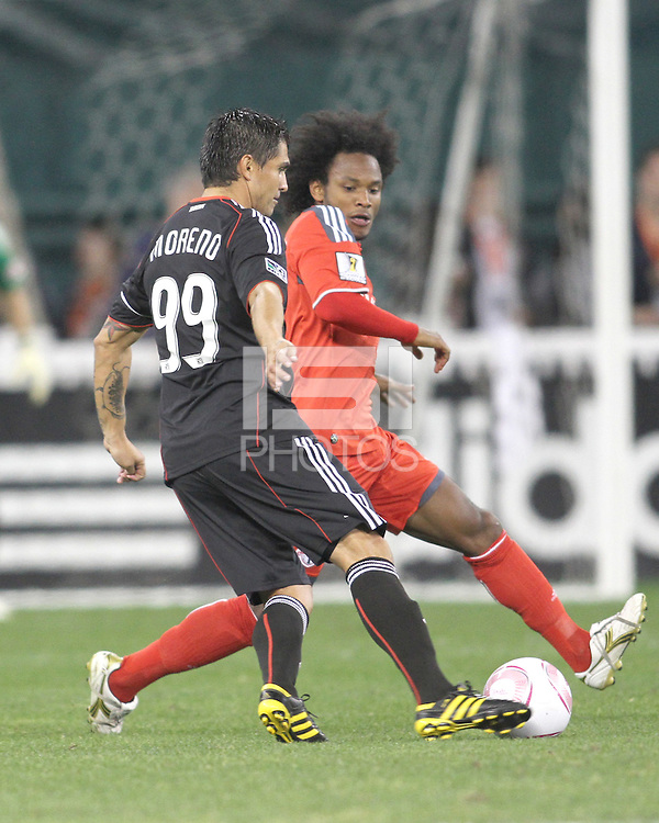 Jaime Moreno #99 of D.C. United attempts to get by Julian de Guzman #6 of Toronto FC during an MLS match that was the final appearance of D.C. United's Jaime Moreno at RFK Stadium, in Washington D.C. on October 23, 2010. Toronto won 3-2.