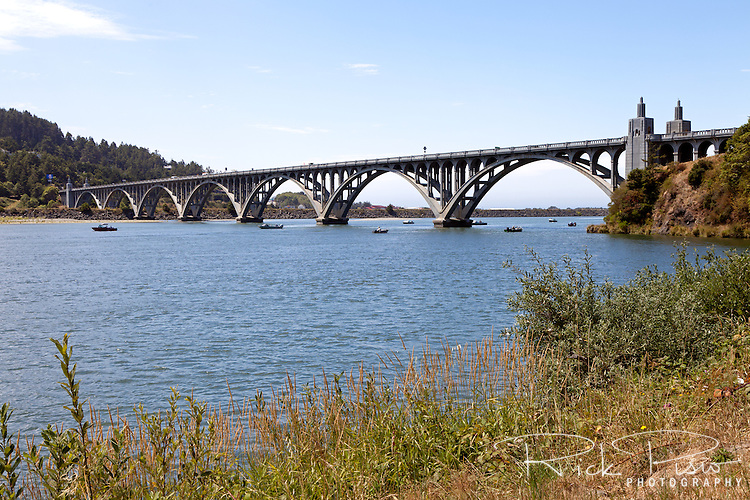 The Isaac Lee Patterson bridge crosses the Rogue River near Gold Beach, Oregon. The 1,898 foot long concrete arch bridge was one of many bridges designed by Conde McCullough for the Oregon Coast Highway. The bridge opened on December 24th, 1932 and was placed on the National Register of Historic Places in 2005.