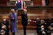 Former Canadian Prime Minister Brian Mulroney, center, shakes hands with former President George Bush, right, after speaking during the State Funeral for former President George H.W. Bush at the National Cathedral, Wednesday, Dec. 5, 2018, in Washington. <br /> Credit: Andrew Harnik / Pool via CNP